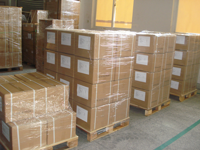 In cartons, and then in pallets, with packing film & belt